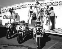 Pro Superbike young guns to the fore at Race City, Alberta in 1991, with Sunoco-FAST Yamaha team-mates Linnley Clarke and Pascal Picotte checking the crowd as Action Honda's Yves Brisson chats with announcer Pat Gonsalves. [Photo: Colin Fraser]