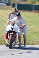 RACE Events Maintance Staff recover MOPAR CSBK National overall Champ Jodi Christie's Honda CBR600RR from turn one following his crash uring Sunday morning's warm-up at the final RACE Regional of 2014 at Shannonville Motorsport Park. [Photo: Colin Fraser]