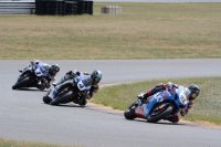 Late in race one of Superbike for MotoAmerica at New Jersey, Roger Hayden's Yoshimura Suzuki leads the works Yamahas of Josh Hayes and Cameron Beaubier. [Photo: Colin Fraser]