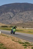Express Lane/Blackfoot Kawasaki's Jordan Szoke drops down the hill into the braking area of turn one at Area27, during an OPP Track Day north of Osoyoos, British Columbia. [Photo: Colin Fraser]