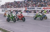Shannonville Motorsport Park CSBK National start in 1992 with Champ Steve Crevier (Kawasaki # 1), Pascal Picotte (FBF-Ducati # 34), Michael Taylor (# 15 Kawasaki) and Linnley Clarke (FAXT-Yamaha # 26). [Photo: Colin Fraser]