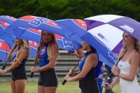 The MotoAmerica podium girls got good use of their umbrellas today at a wet Barber Motorsports Park. [Photo: Colin Fraser]