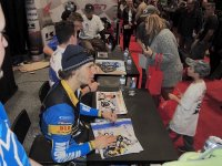 Still wearing his riding gear from his Trials Demonstration duties at the Toronto Motorcycle Show, current Mopar CSBK National Superbike Champion Jordan Szoke chats with the fans during the annual Saturday Autograph session. [Photo: Colin Fraser]