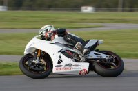 Newly crowned Hindle Pro Sport Bike National Champ Kenny Riedmann had a strong Pro Superbike debut at the final 2014 Shannonville Regional aboard a newly aquired Sturgis Cycle Aprilia RSv4 1000.  [Photo: Colin Fraser]