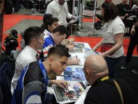 Following interviews at the Motorcycle Show – Toronto, stars of the Mopar CSBK Canadian National Superbike Championship signed autographs for race fans on hand. [Photo: Colin Fraser]