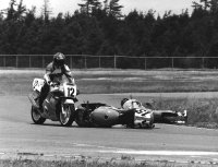 In 1994, the biggest road race of the Canadian Series was the annual RACE Superbike Challenge weekend in July at Shannonville Motorsport Park.  In Pro Sport Bike action, leader Owen Weichel (Honda # 12) tries to avoid the FAST-Kawasaki of faller Michael Taylor entering Allen's Corner. [Photo: Colin Fraser]