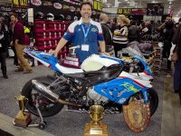 Veteran Mopar CSBK front runner Michael Leon, 2016 RACE SuperSeries overall Champion, shows off some of his hardware in front of his BMW S1000RR at the Royal Distributing Show booth. [Photo: Colin Fraser]