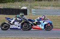 Fight for first in race two of Superbike for MotoAmerica in New Jersey, and Toni Elias (Suzuki GSX-R1000) dives under Josh Hayes (Yamaha YZF-R1) for the lead. [Photo: Colin Fraser]