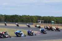 Josh Hayes leads the works Suzukis and the rest of the MotoAmerica Superbike and Superstock pack on the first lap of race two at New Jersey, the final National round of 2016. [Photo: Colin Fraser]