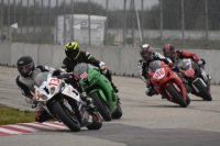 Argyll Motorsports backed Intermediate Superbike fight for first at Castrol Raceway, with Jeffrey Sanderson (BMW # 13) leading Eric Russnak (Honda # 76), Luke Salt (Suzuki # 146) and Justin Gehlert (Suzuki # 113). [Photo: Colin Fraser]